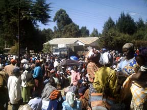 Victims queue for food rations in Molo, Kenya